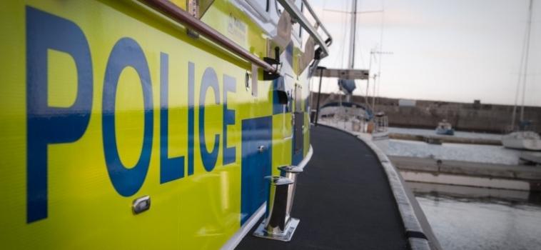 Police Patrol Boat heads North